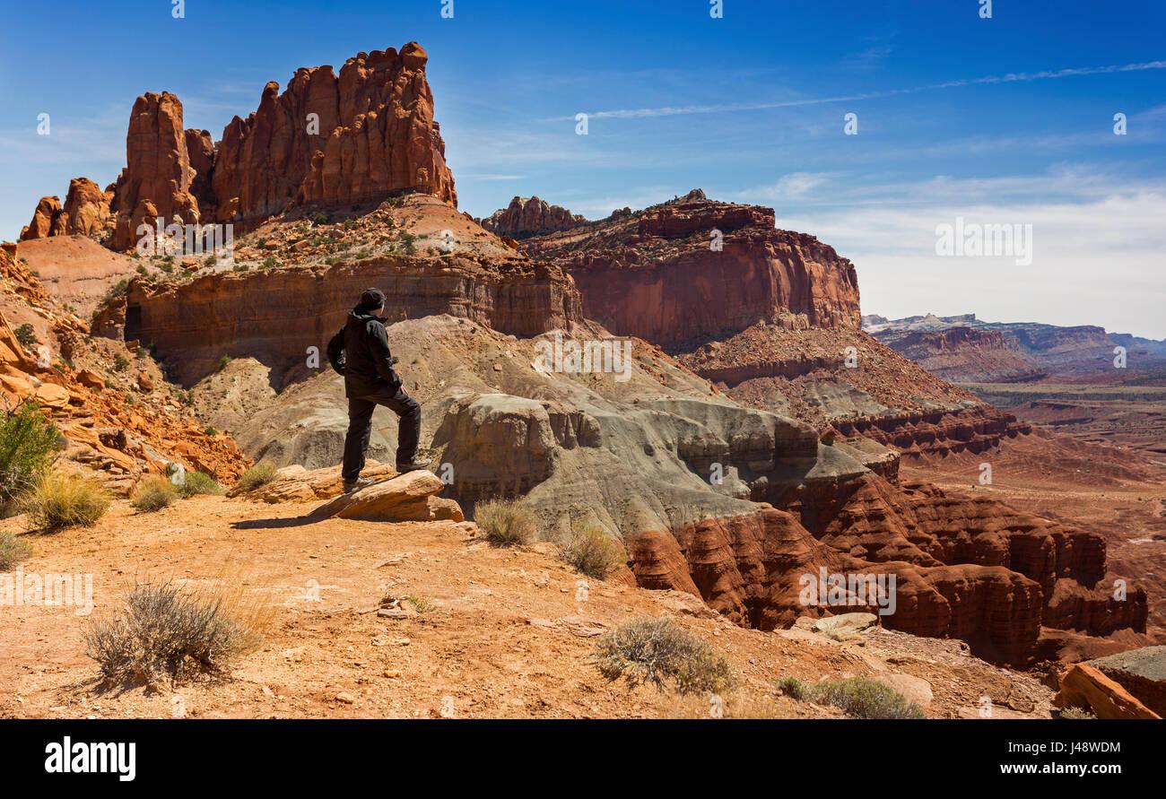 Lonely Hiker enjoying views of Capitol Reef National Park, Utah, United States - Stock Image