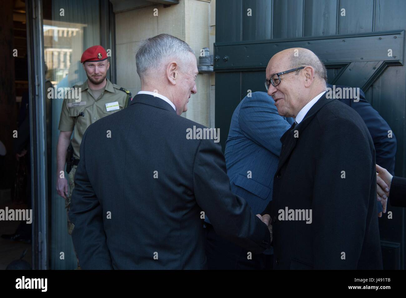 U.S. Secretary of Defense Jim Mattis, left, welcomes French Defence Minister Jean-Yves Le Drian, right, for the - Stock Image