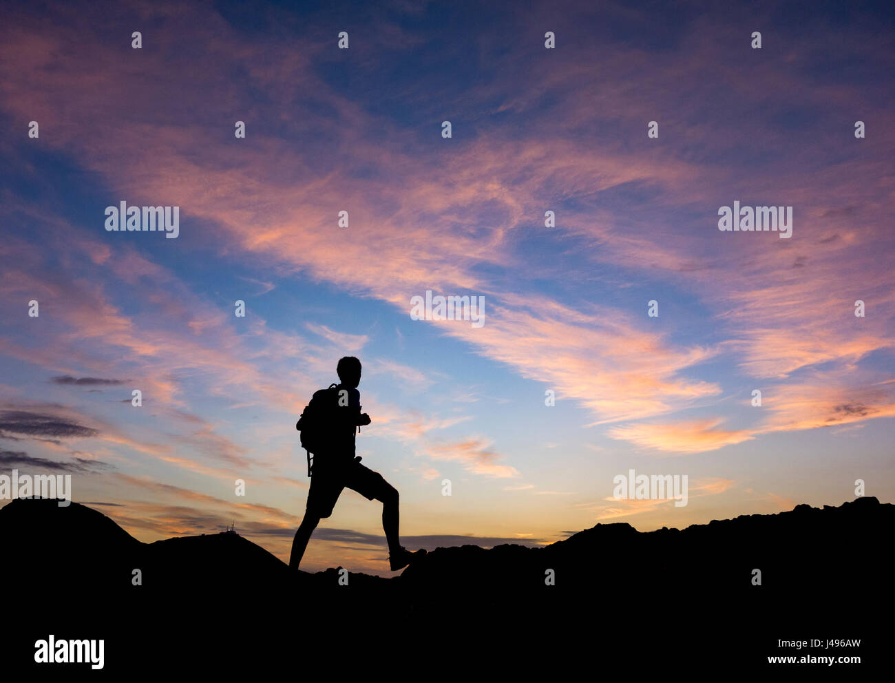 Las Palmas, Gran Canaria, Canary Islands, Spain. 11th May, 2017. Weather: A trail runner on volcanic mountain as Stock Photo