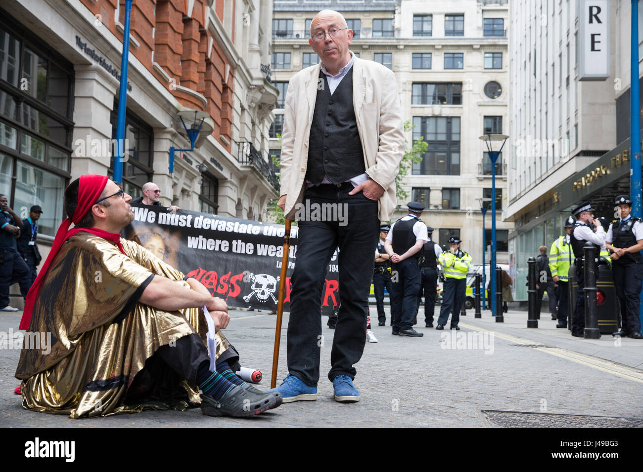 London, UK. 11th May, 2017. Ian Bone (r) of Class War talks to a Life Not Money activist during a protest in solidarity - Stock Image