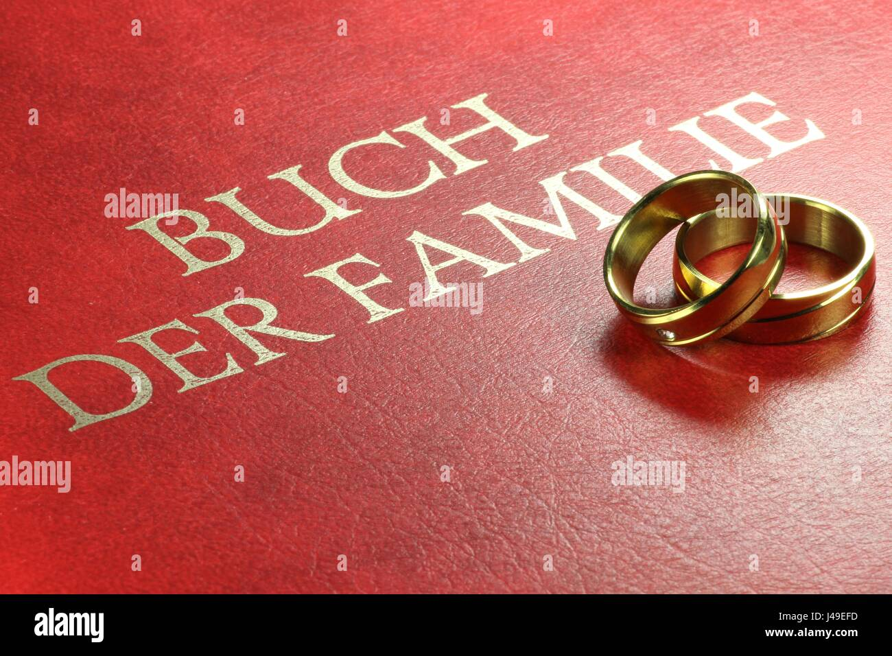 Golden wedding rings on German family book Stock Photo: 140350545 ...