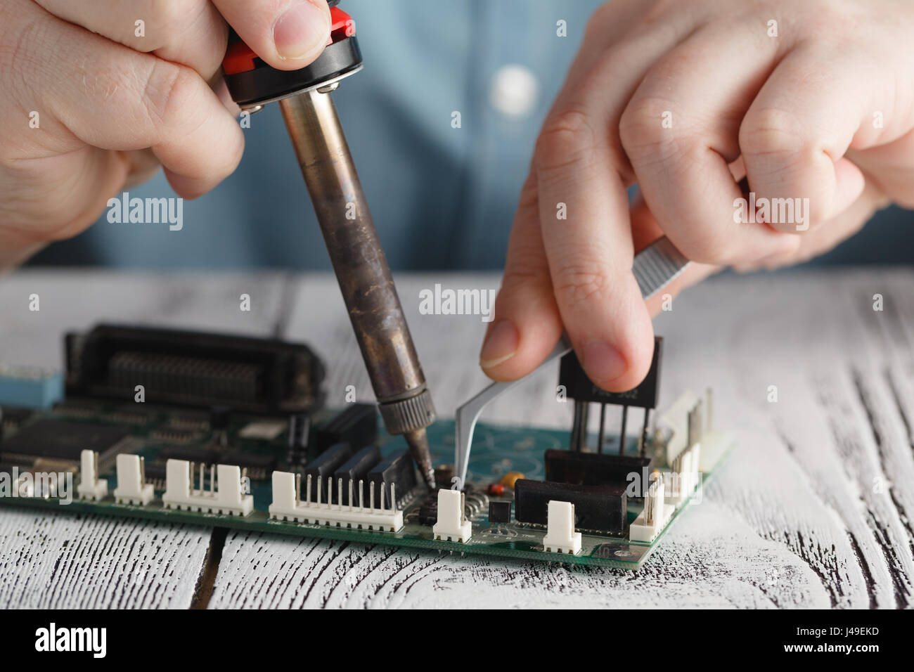 Soldering Iron For Circuit Board Repair Complete Wiring Diagrams Best Solder Boards Engineer With Stock Photo Rh Alamy Com Electronics Jumpers