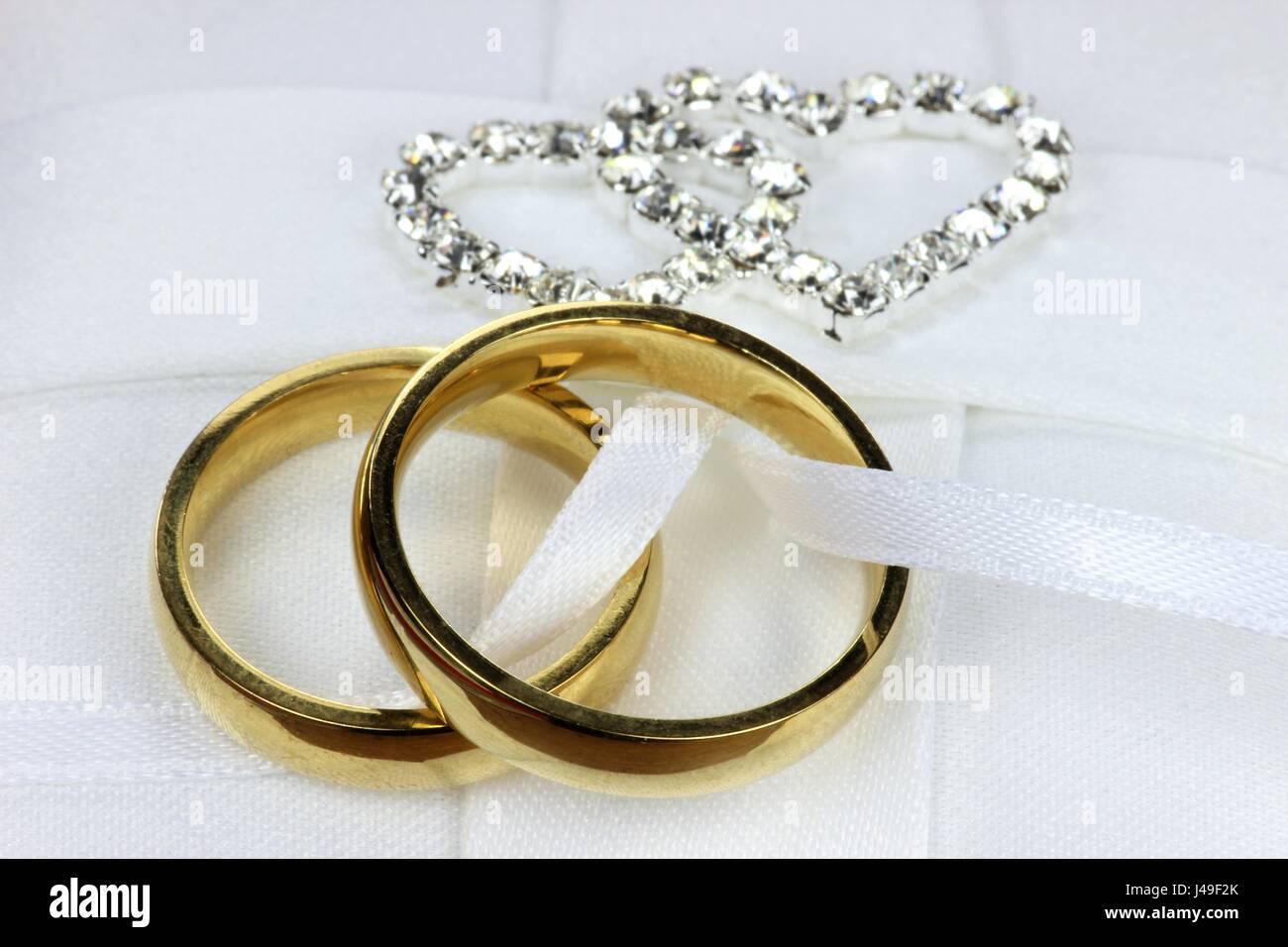 Golden Wedding Rings On White Ringbearer Pillow Stock Photo