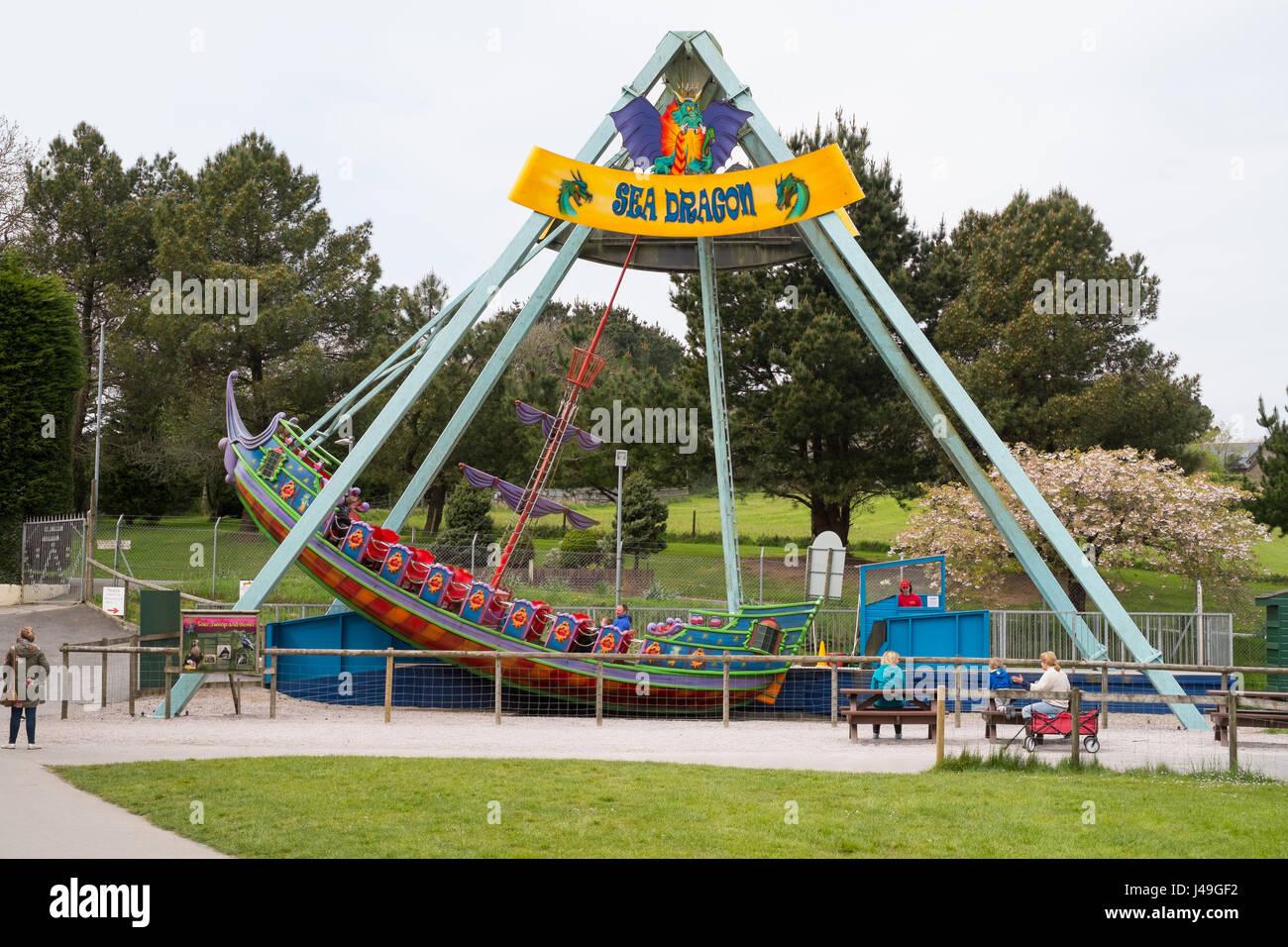 Sea Dragon swinging boat ride at Woodlands Family Theme Park, Totnes, Devon , England, United Kingdom. - Stock Image