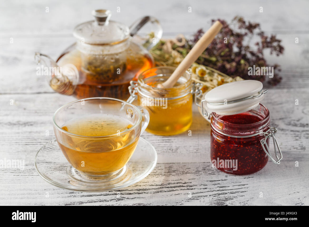 Jar with raspberry jam - Stock Image