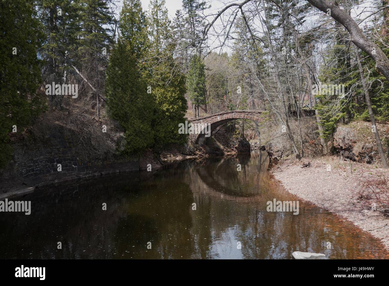 A footbridge over a creek at Glensheen Mansion in Duluth, Minnesota, USA. - Stock Image