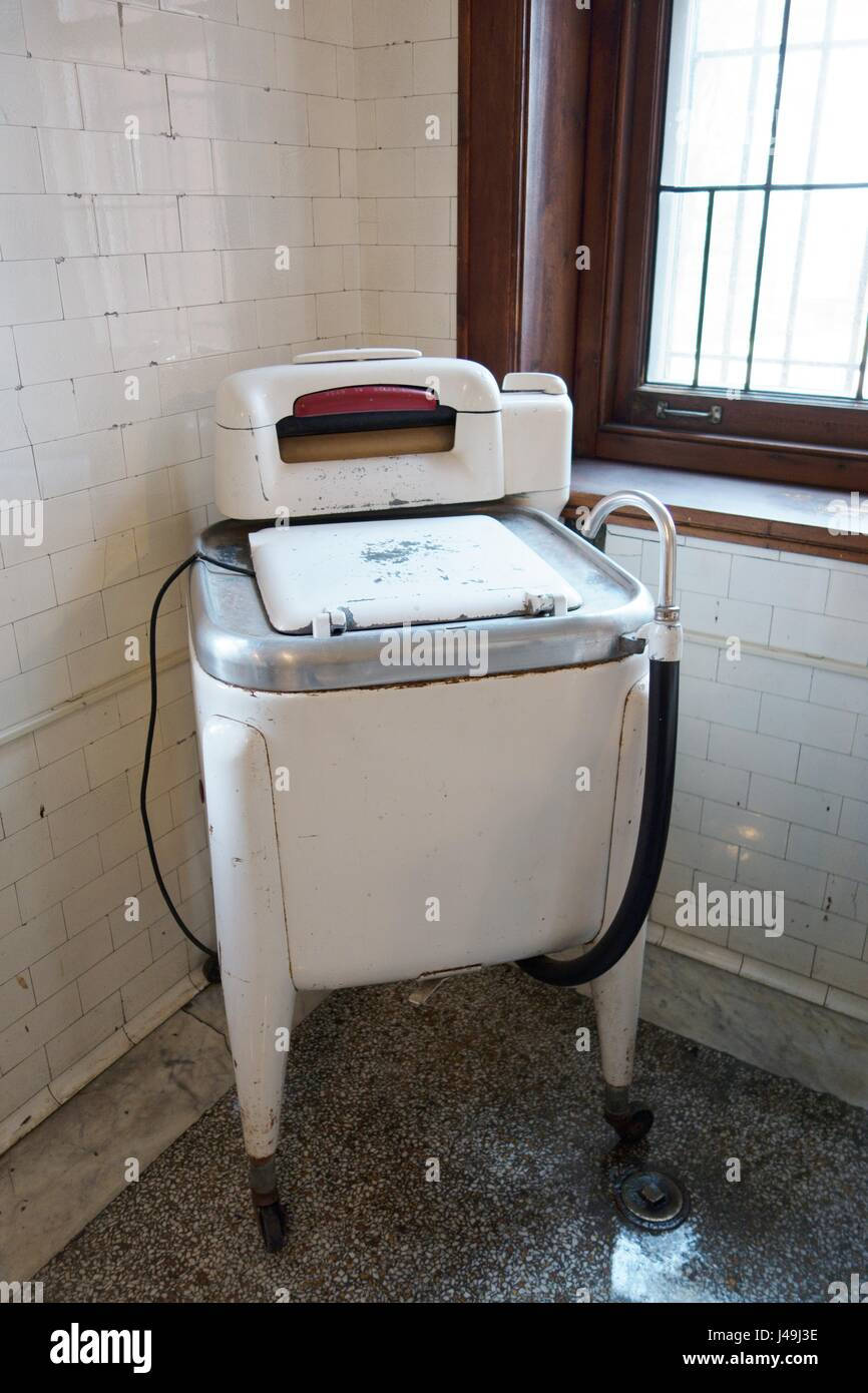 An old fashioned washing maching, in the laundry room at Glensheen Mansion in Duluth, Minnesota, USA. - Stock Image