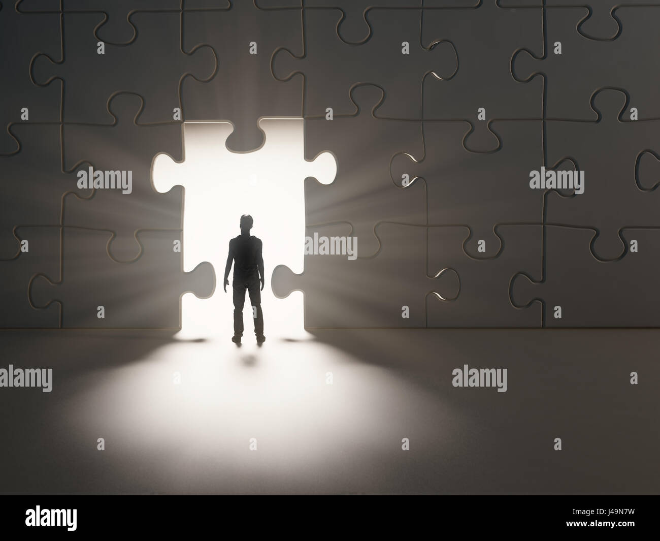 Man walking thourgh a break in a jig-saw puzzle wall - 3D illustration - Stock Image