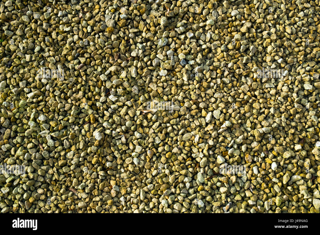 Limestone chippings hard landscaping surface - Stock Image