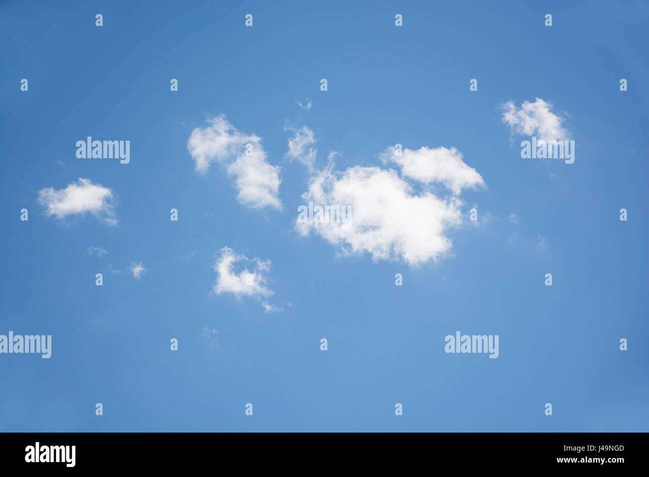 white clouds in the blu summer sky Stock Photo