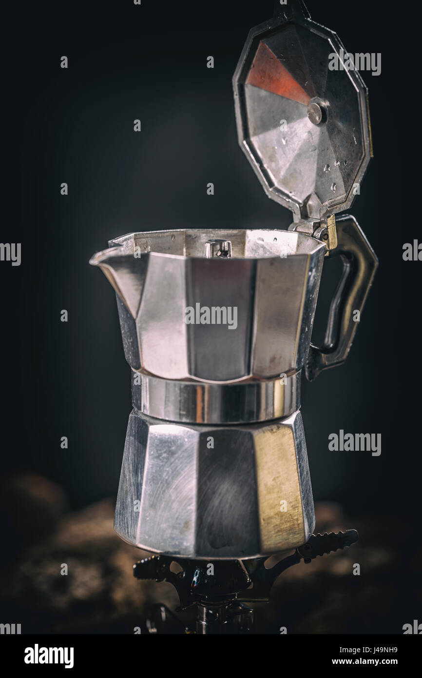 Moka coffee pot on stove. Old style coffee in soft vintage tone. - Stock Image