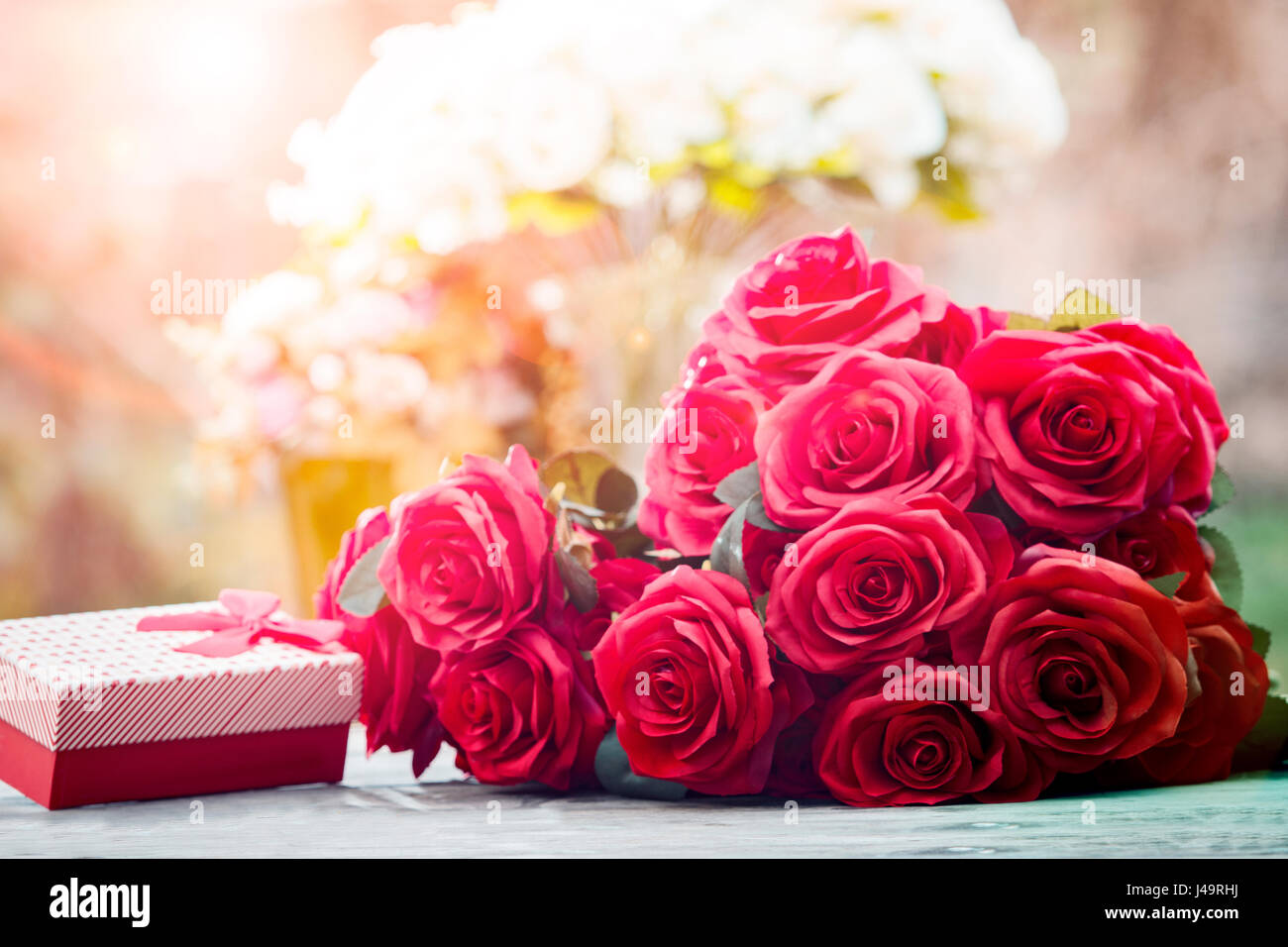 red roses flowers with valentine festival gift and beautiful blur ...