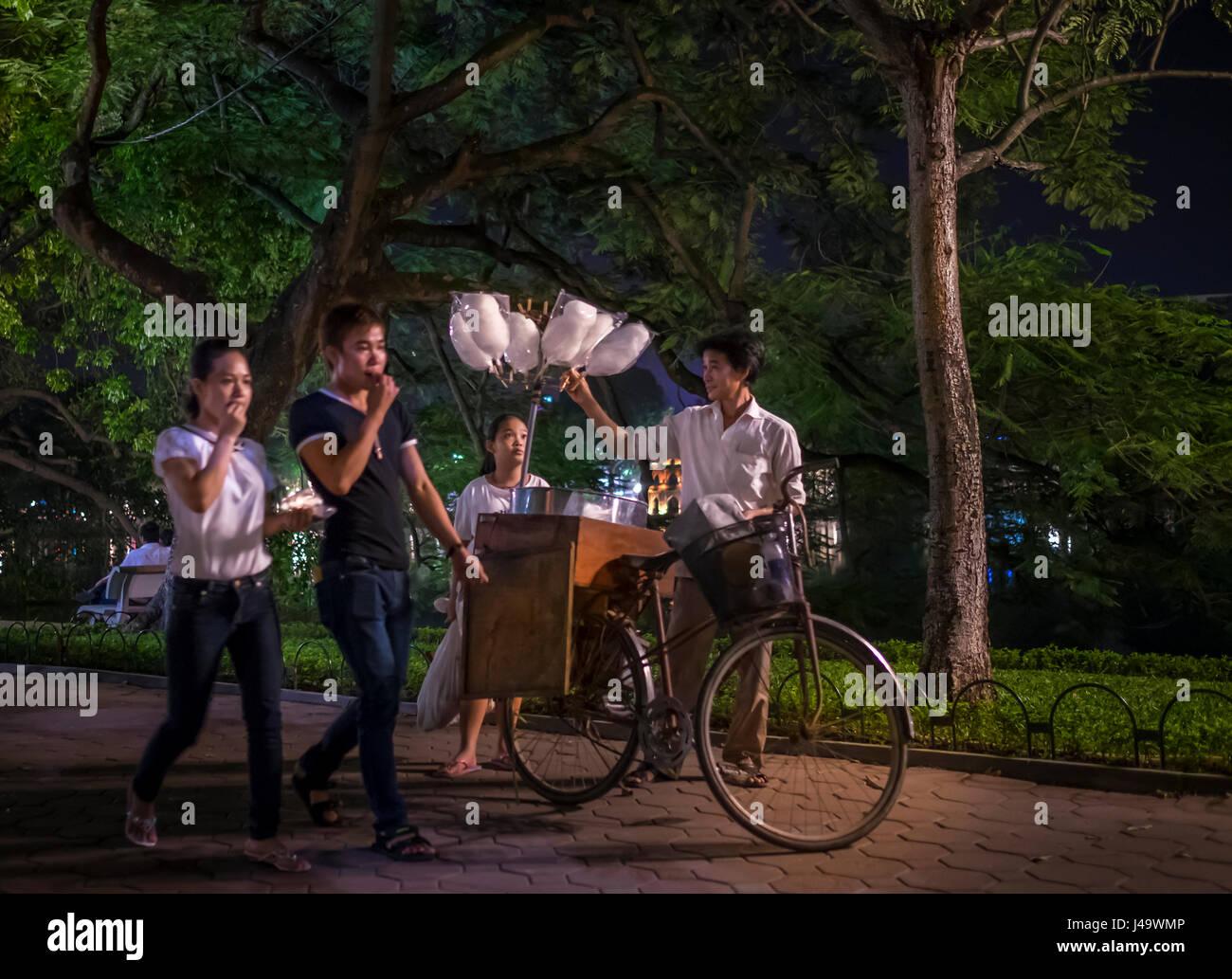 HANOI, VIETNAM - CIRCA SEPTEMBER 2014:  People walking at the Hoan Kiem Lake at night in Hanoi, Vietnam. - Stock Image