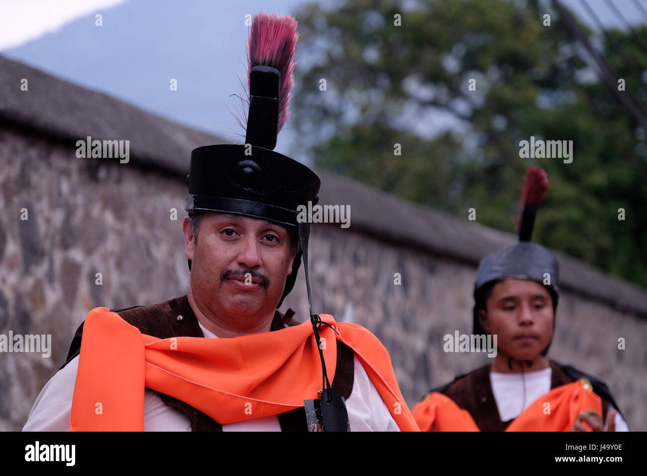 People dressed as Roman warrior during Semana Santa or Holy week celebration in the city of Antigua Guatemala - Stock Image