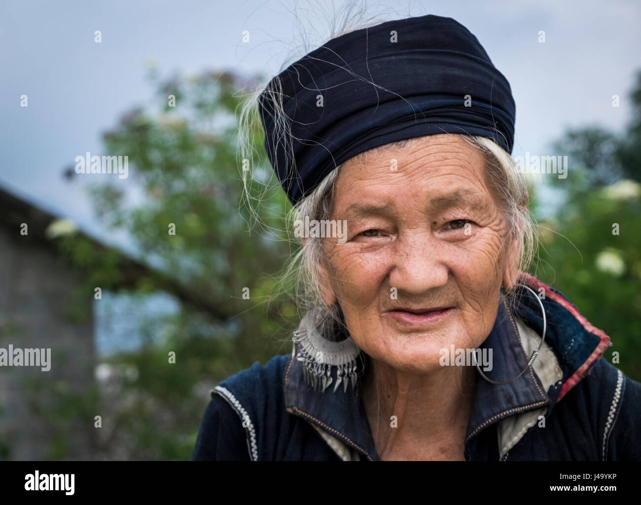 SAPA, VIETNAM - CIRCA SEPTEMBER 2014:  Portrait of woman from the Black Hmong minority in North Vietnam - Stock Image