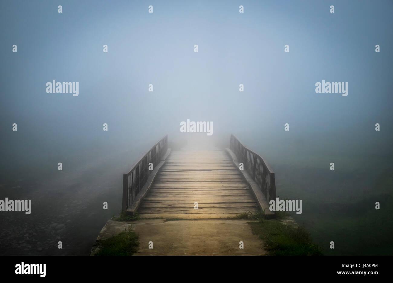 SAPA, VIETNAM - CIRCA SEPTEMBER 2014:  Bridge covered by mist at the Ta Phin Village in North Vietnam - Stock Image