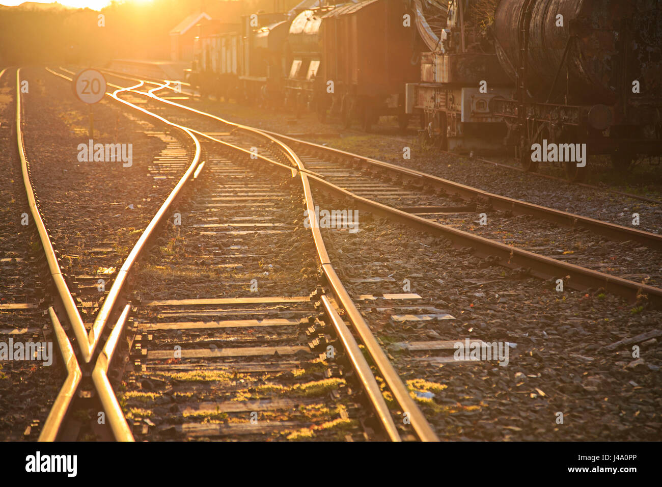 Twisting railway tracks as the sun sets - Stock Image