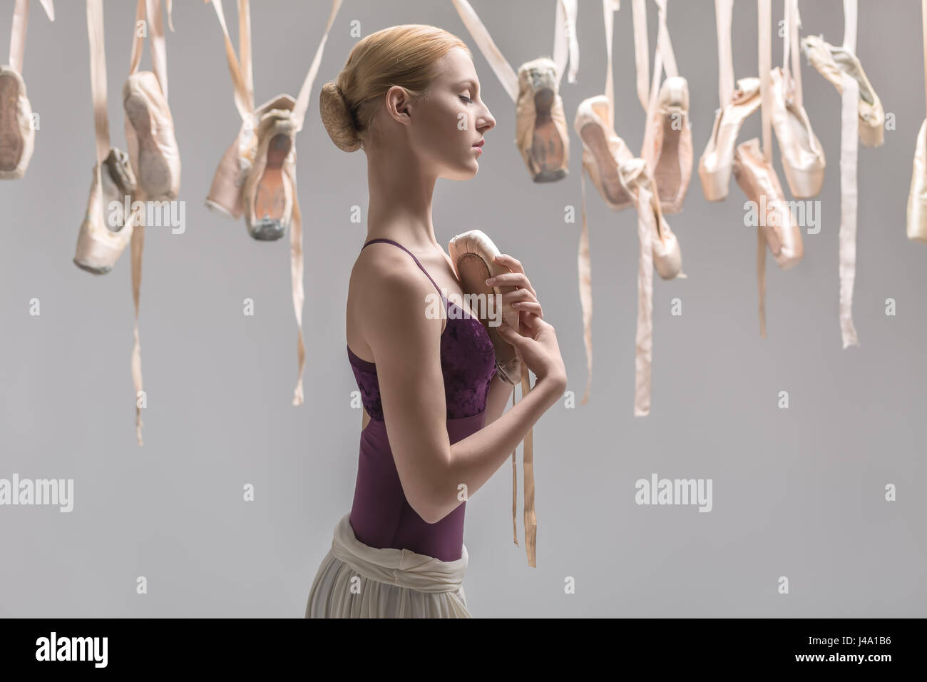 Blonde ballerina and pointe shoes - Stock Image