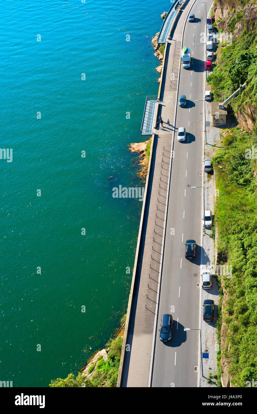 Cars on a road near the river, aerial view. Porto, Portugal - Stock Image