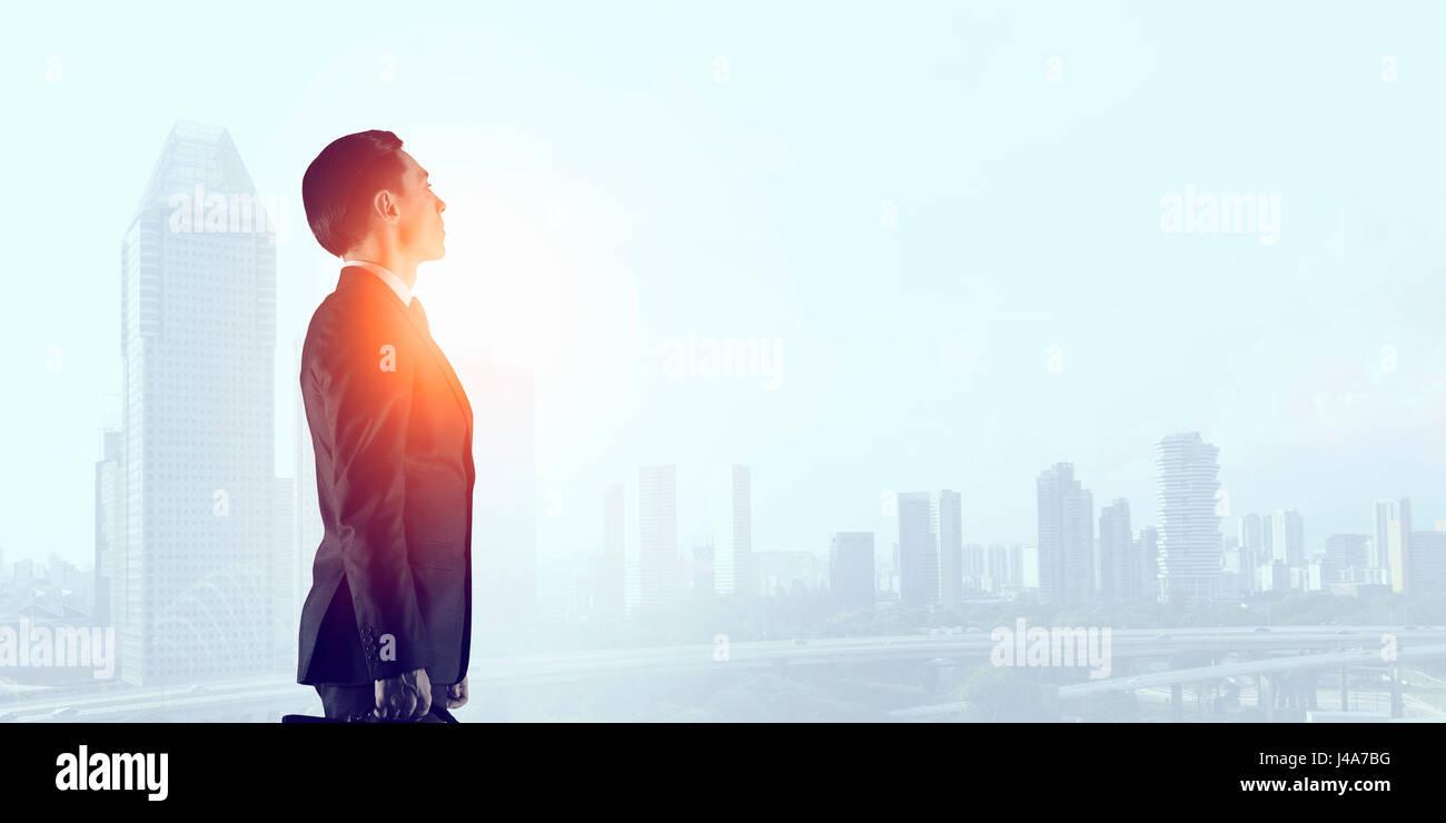 Businessman in big city - Stock Image