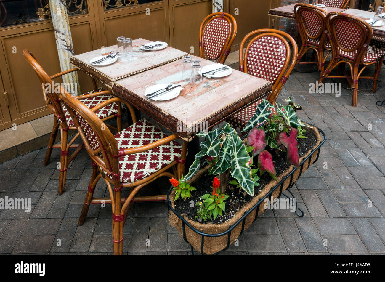 Table for four outside an Italian restaurant on Mulberry Street in Little Italy awaits customers - Stock Image