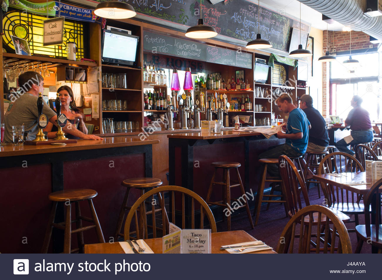 People Sitting At The Bar Inside Hilltop Ale House 2129 Queen Anne