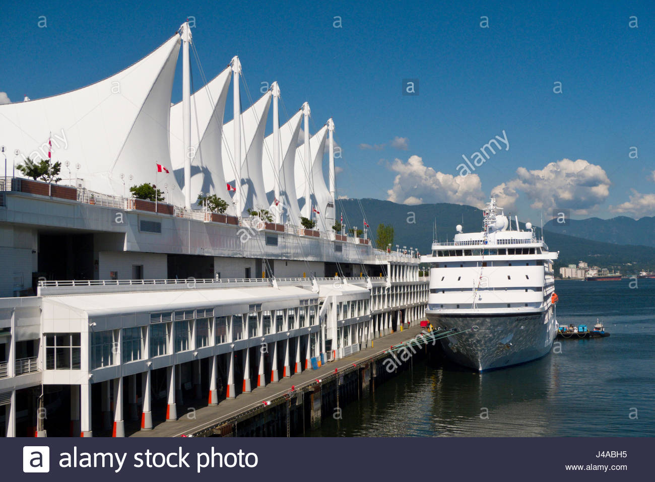 The Regency Seven Seas Navigator cruise ship docked at Canada Place, Vancouver, British Colombia, Canada - Stock Image