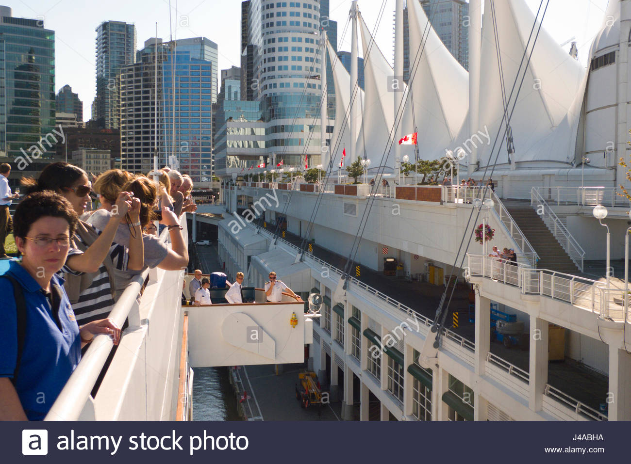 Passengers on the Regency Seven Seas Navigator cruise ship leaving Canada Place, Vancouver, British Colombia, Canada - Stock Image