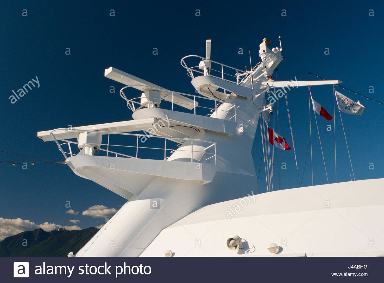 Radar on mast of the Regency Seven Seas Navigator cruise ship, Canada Place, Vancouver, British Colombia, Canada - Stock Image