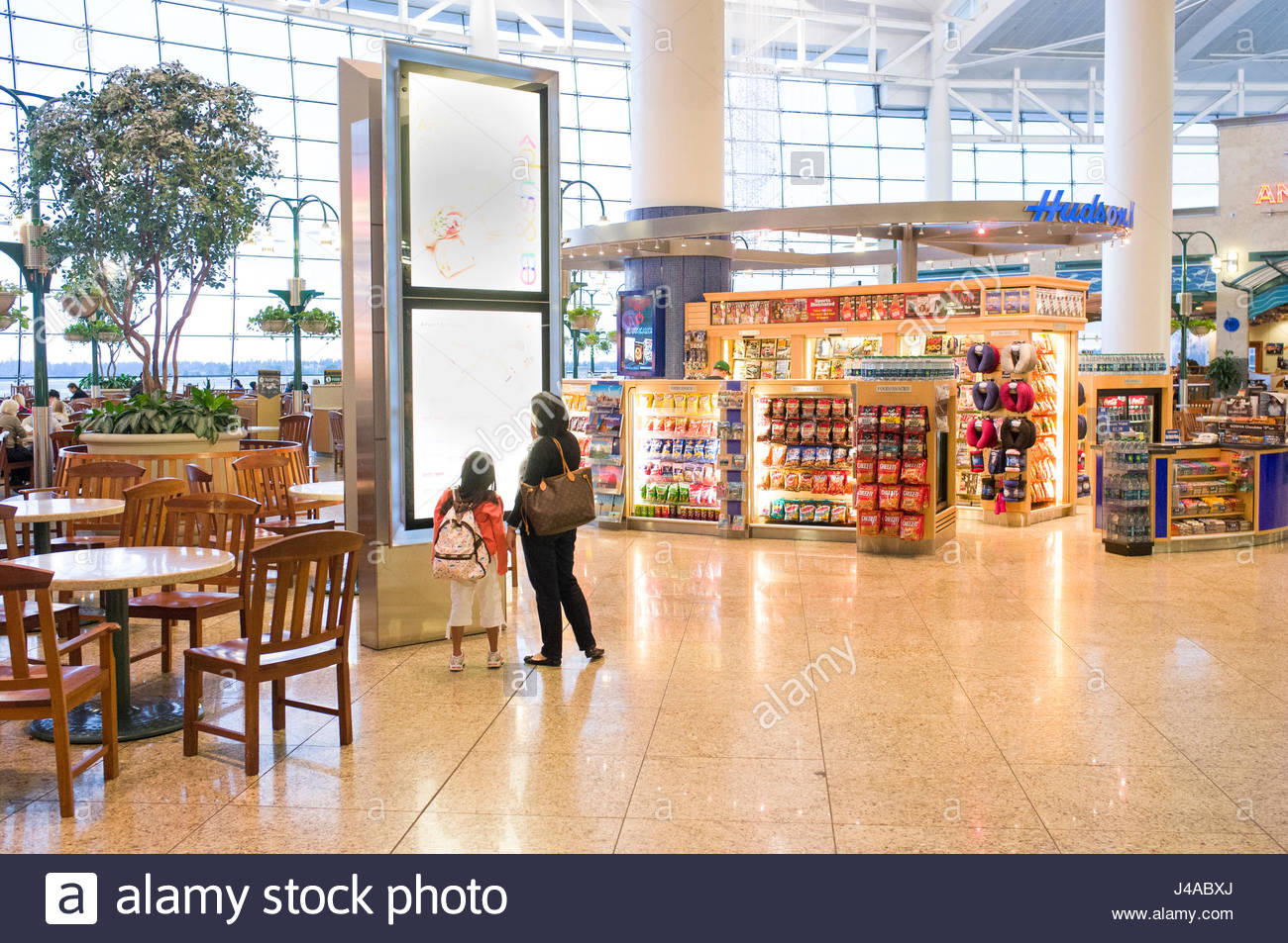 Woman with young girl looking at terminal map in the central ...