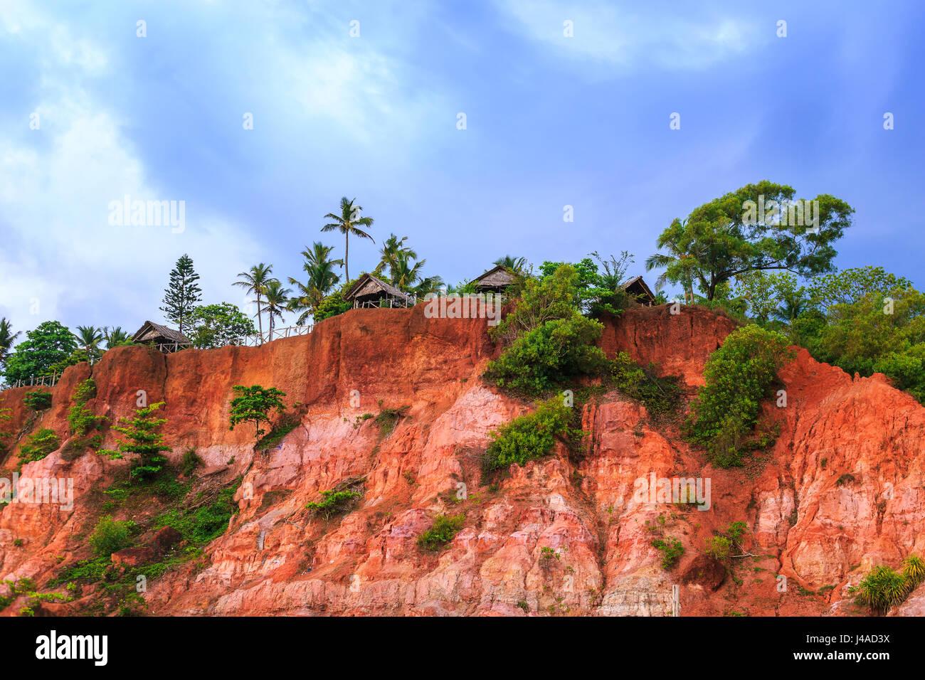 Fishing huts on the cliff. Varkala, Kerala state, South India. Stock Photo