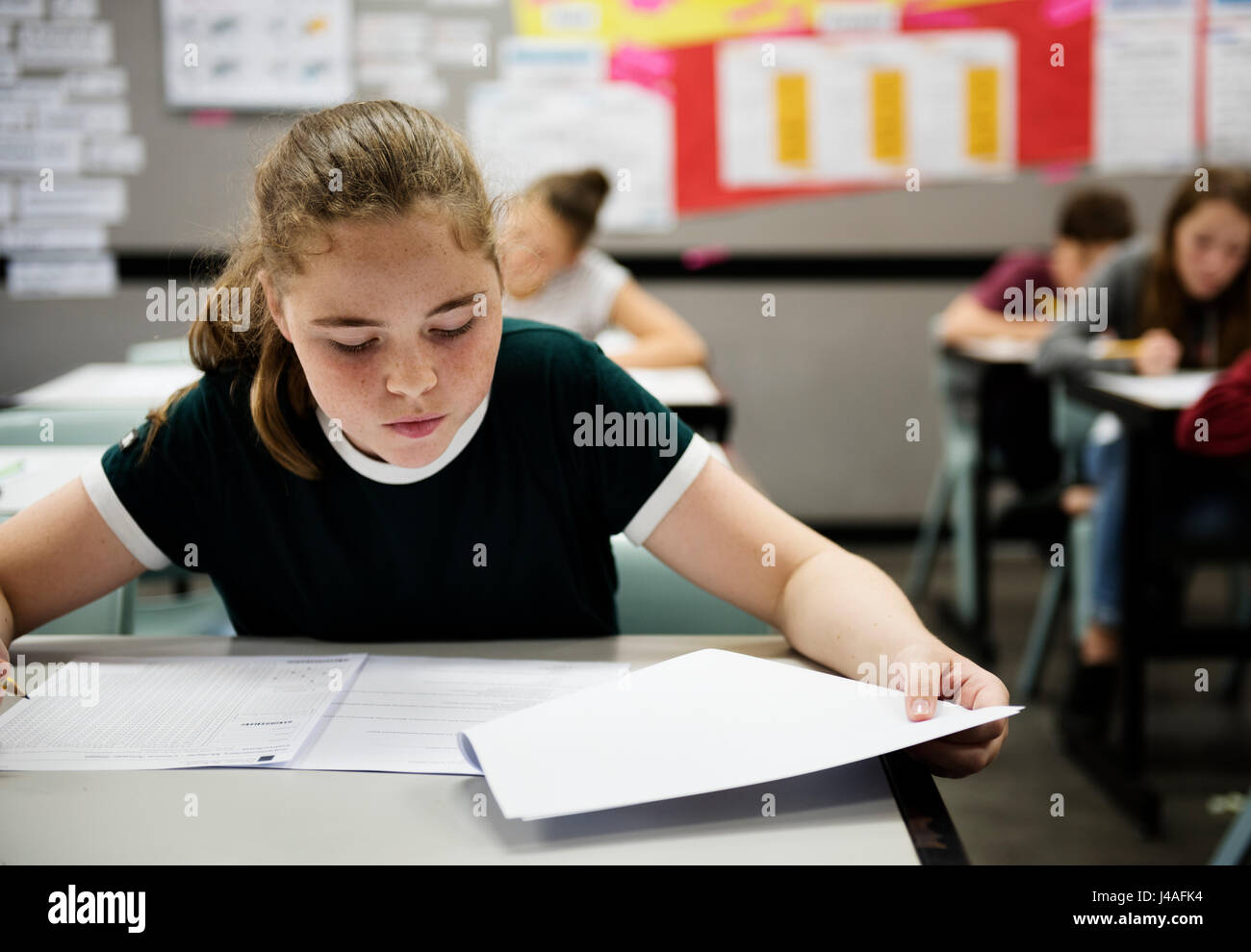 Students doing exam in classroom Stock Photo: 140373384 - Alamy