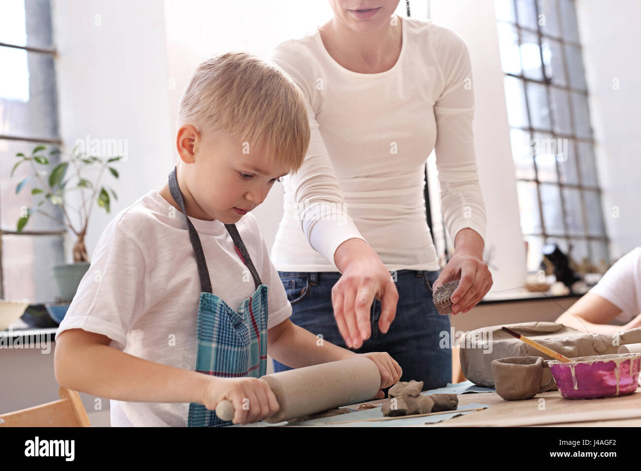 Extracurricular activities, ceramics. Animation classes for children, ceramics and clay - Stock Image