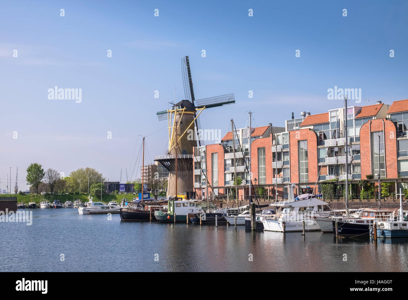 Windmill and boats in the historic area of Delfshaven, Rotterdam, The Netherlands. Stock Photo