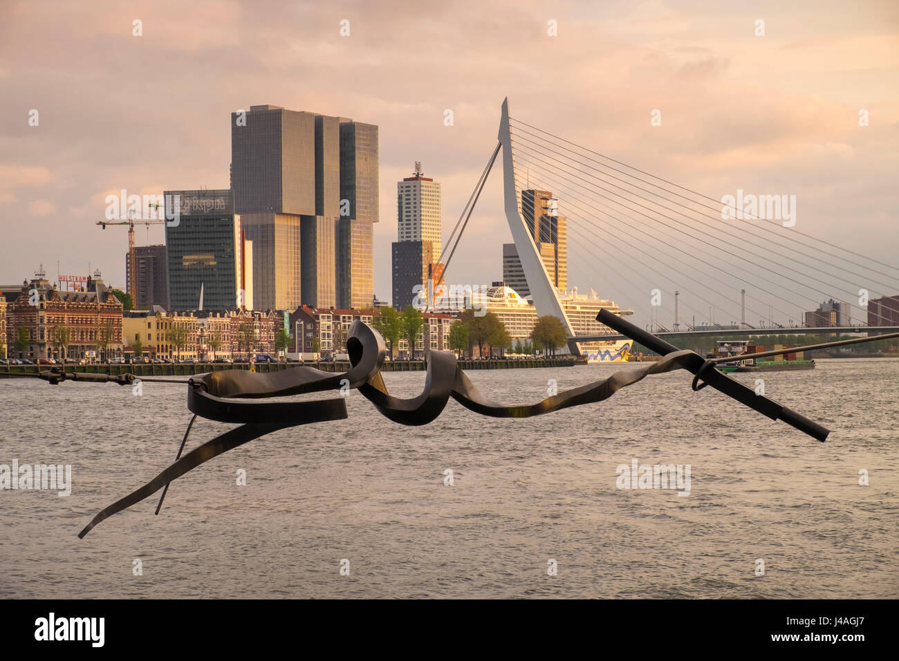 Examples of modern architecture including Erasmus Bridge and De Rotterdam seen alongside the Maas river, Rotterdam, Stock Photo