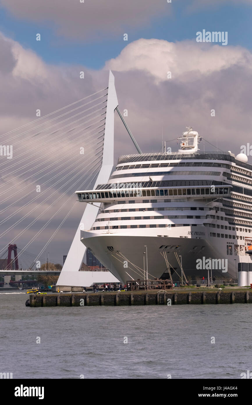Modern large cruise ship at Wilhelmina Pier, with Erasmusbrug (Erasmus Bridge) in the background, Katendrecht, Rotterdam, Stock Photo