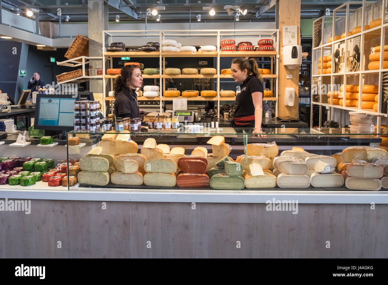 Cheese food stall inside the Markthal indoor food market building, Rotterdam, The Netherlands. - Stock Image