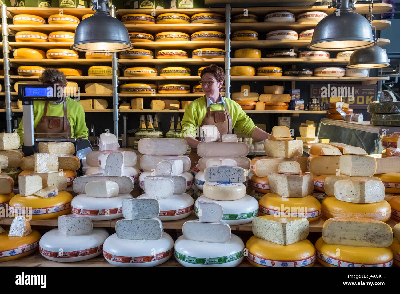 Cheese trader inside Markthal food market, Nieuwstraat, Rotterdam, The Netherlands - Stock Image