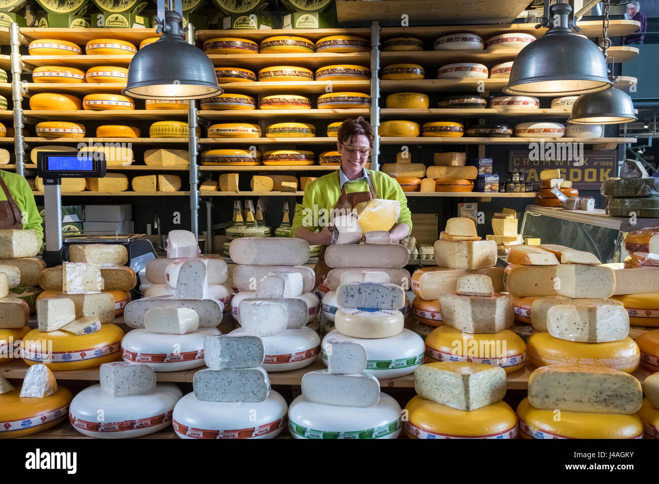 Cheese seller inside Markthal food market, Nieuwstraat, Rotterdam, The Netherlands - Stock Image