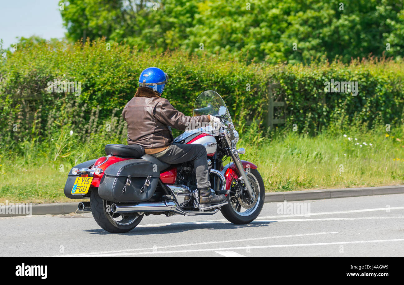 Triumph Thunderbird Commander motorcycle fitted with leather saddlebags. Man riding a Triumph motorbike fitted with - Stock Image
