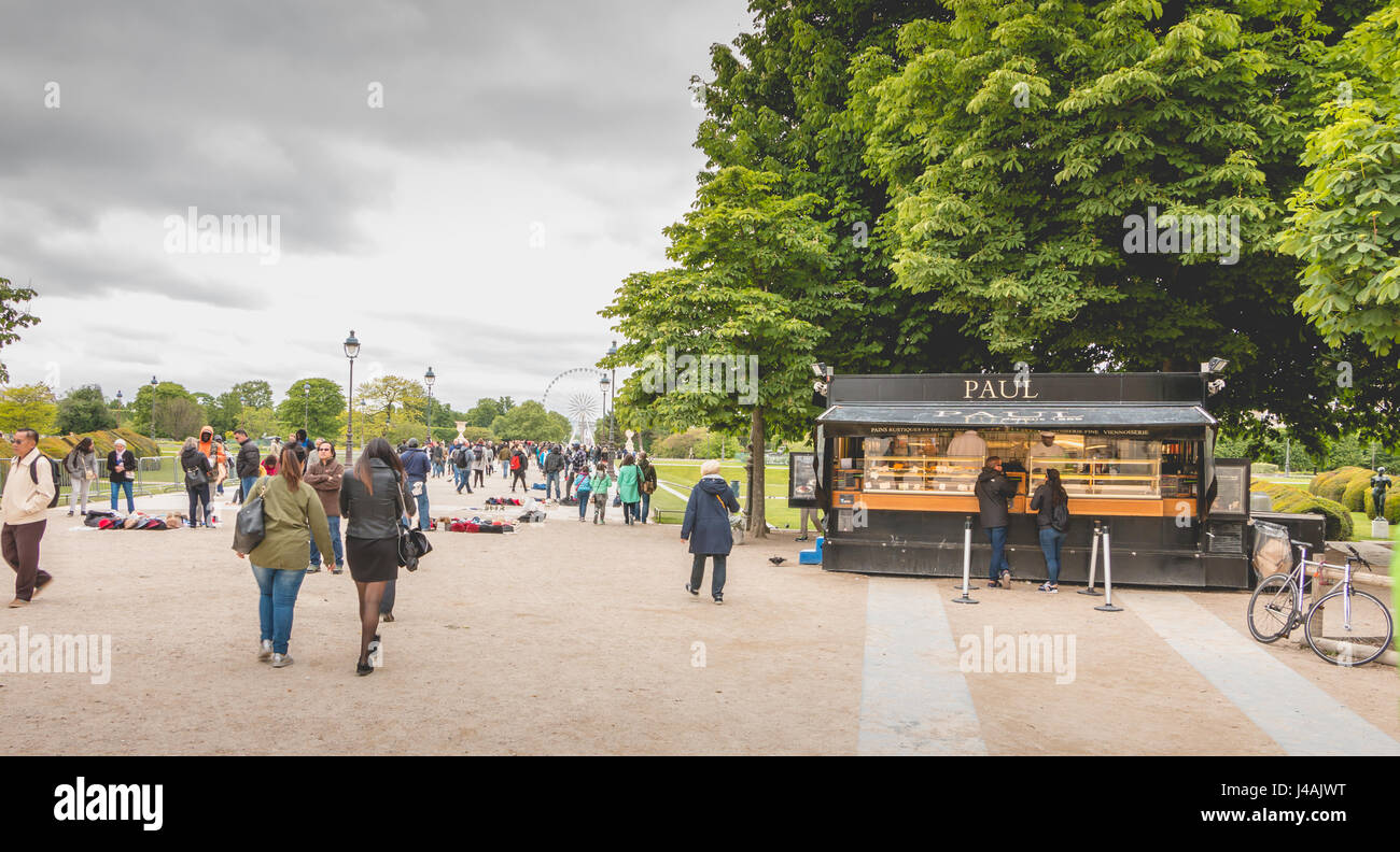 Paris, France - May 08, 2017 : In the garden of the Tuileries, in Paris, tourists buy food at Paul, a chain of shops - Stock Image