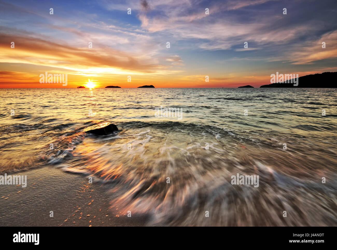 Beautiful sunset at the beach in Kota Kinabalu, Sabah Borneo, Malaysia. - Stock Image