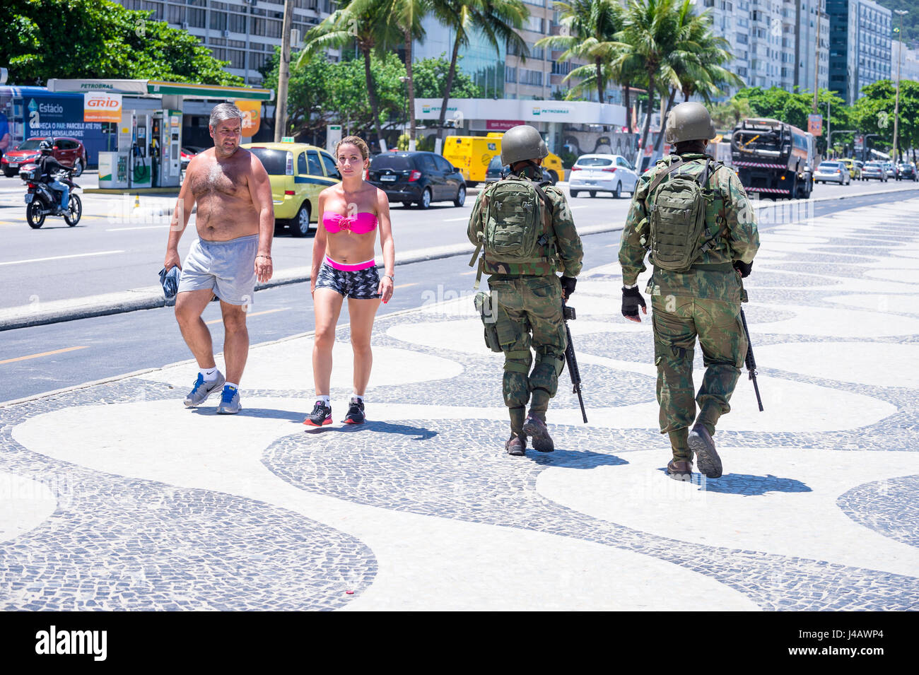 RIO DE JANEIRO - FEBRUARY 15, 2017: Two Brazilian Army soldiers stand in full camouflage uniform on the boardwalk - Stock Image