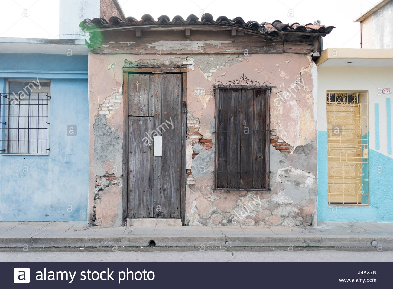 Cuban old weathered and worn out architecture. Urban contrast.  Results of economic hardship on real estate. - Stock Image