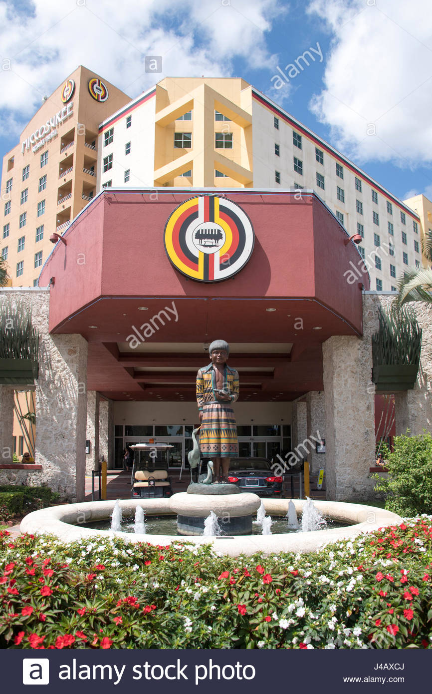 Miccosukee Resort & Gaming Casino Games. Entrance detail featuring  a colored statue of a young Miccosukee boy - Stock Image