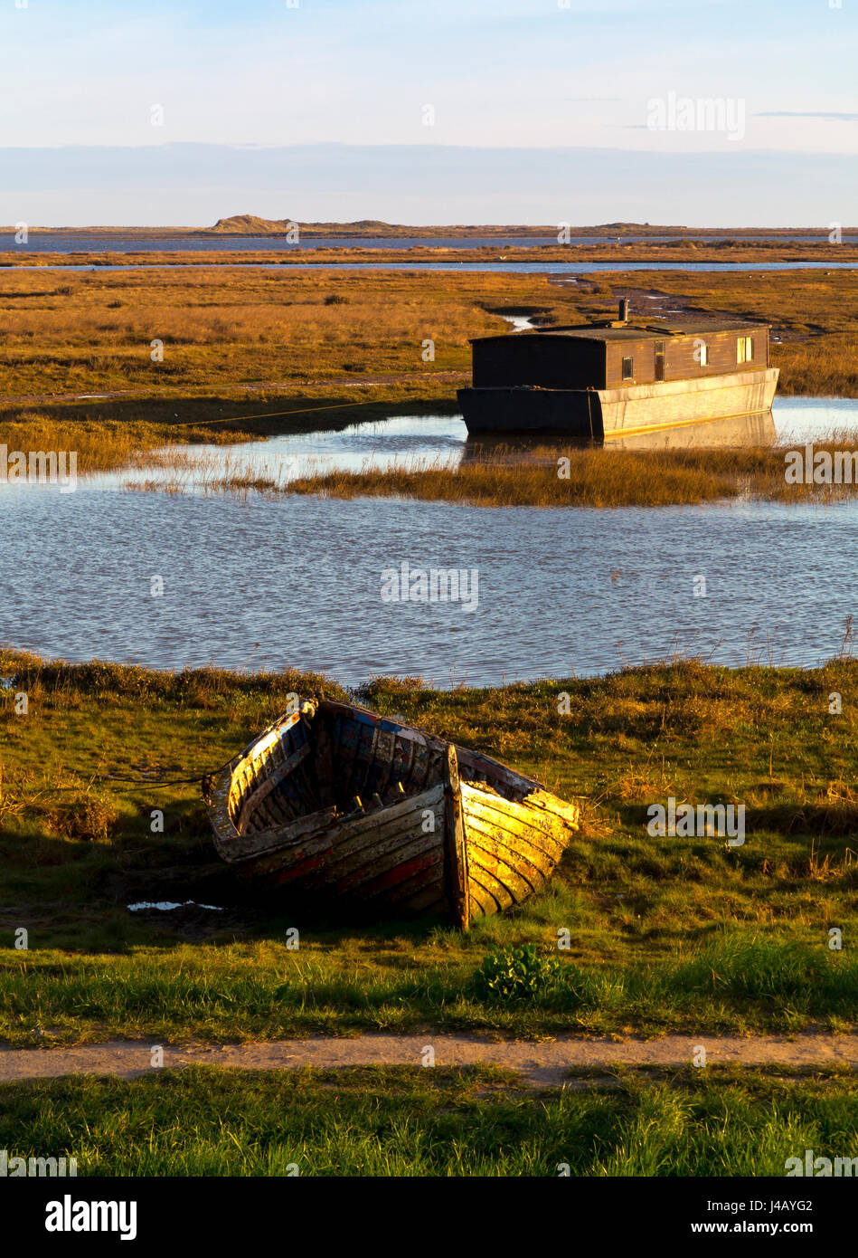 The coastline and saltmarshes at Burnham Deepdale on the North Norfolk coast in England UK Stock Photo