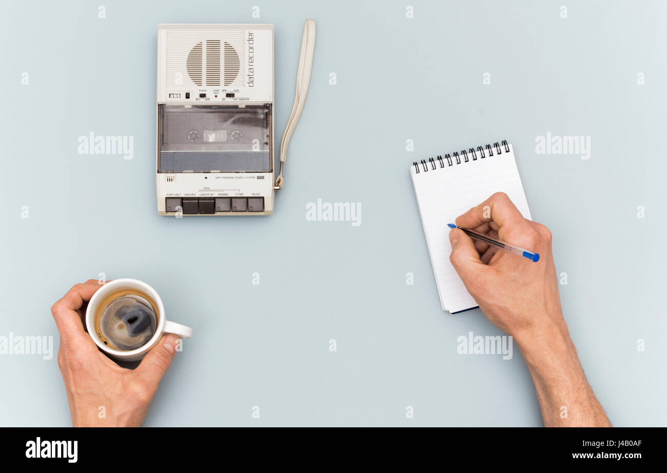 reporter or interrogation table with tape recorder - Stock Image