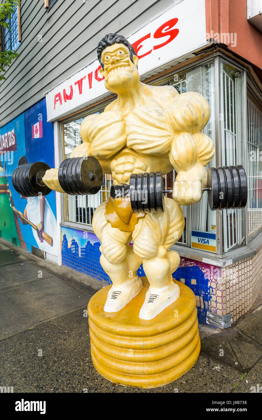 Storefront fitness weight lifter barbell dummy - Stock Image