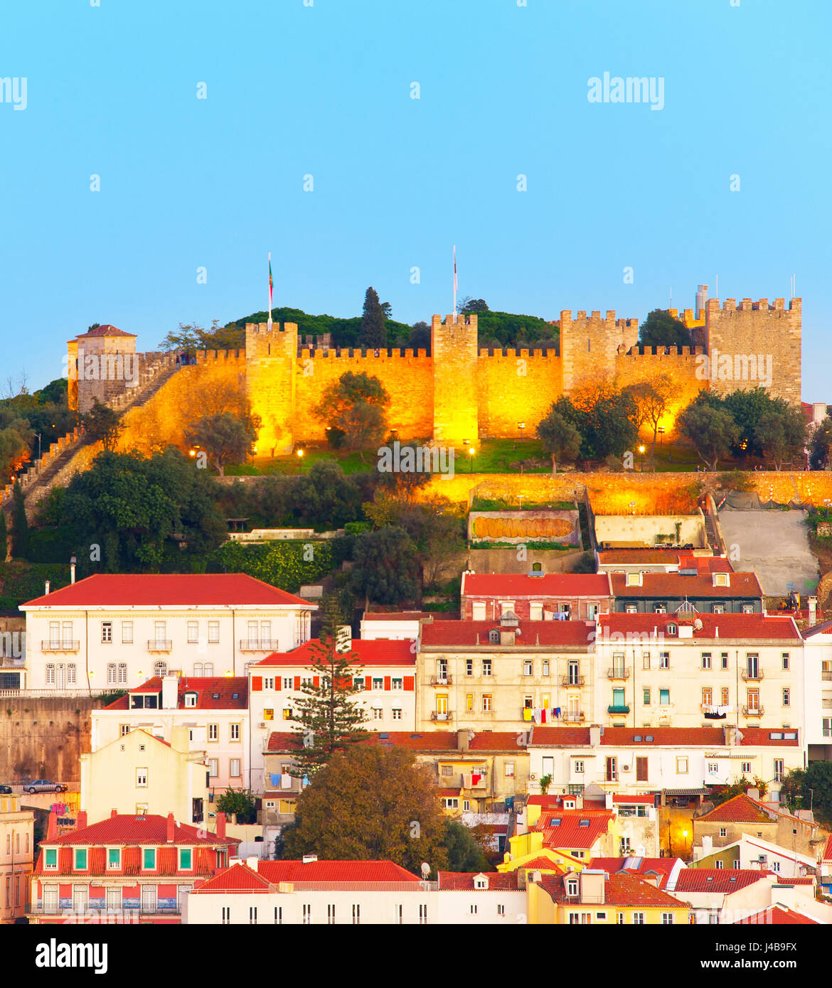 Lisbon Castle on a top of a hill at dusk. Lisbon, Portugal - Stock Image
