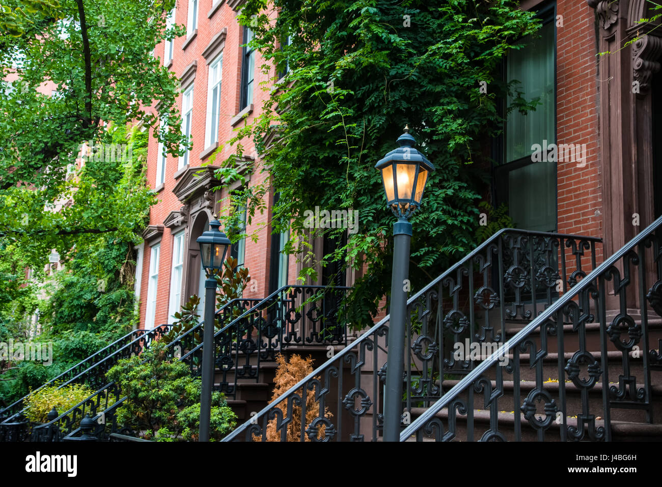 vintage lamp post near old apartment buildings in greenwich village